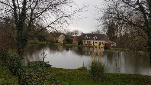 French house by a pond